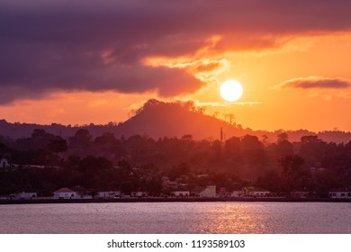Sunset over Sao Tome Nature landscape of Sâo Tomé and Principe. Mountains like Pico Cão Grande. Travel to Sao Tome and Principe. Beautiful paradise island in Gulf of Guinea. Former colony of Portugal.