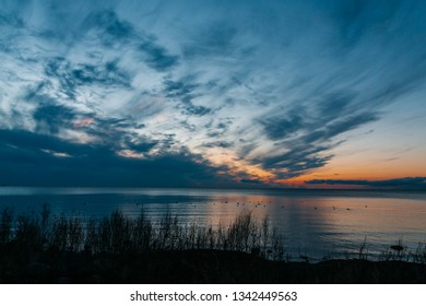 Sunset over the sea and amazing cloudscape