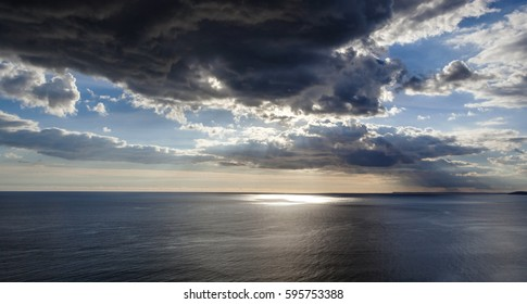 Sunset over the sea with amazing sky and clouds - ocean panorama, taken in Whitsand Bay, Cornwall, UK.