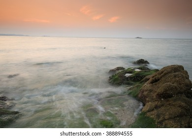 sunset over the sea beach , long exposure of the wave during sunset on the beach