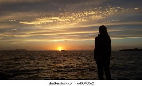 Sunset over the sea from Ibiza island