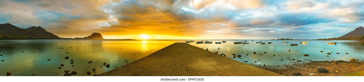 Sunset over sea. Le Morn Brabant on background. Mauritius. Panorama