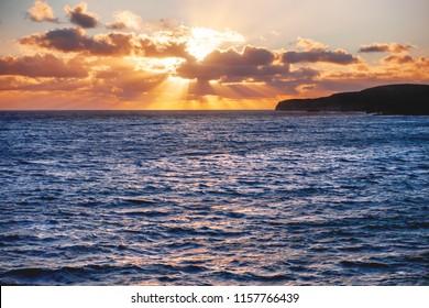 Sunset over the sea near the Gozo island, Malta.