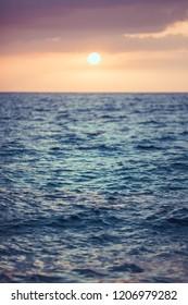 Sunset over sea. Quiet ocean and tender sunrise.