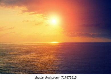 Sunset over sea. Sea shore with beautiful picturesque sky