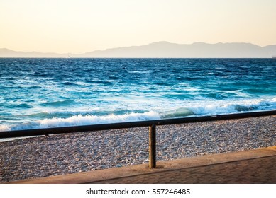 Sunset over the sea, with a strong shadow, blue sea and beaches