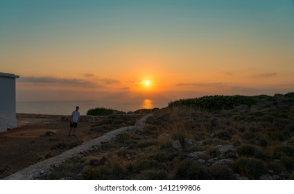 sunset over the sea and walking young man