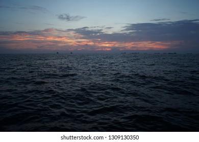 Sunset over the sea in Xi Zi Wan bay, Kaohsiung, Taiwan