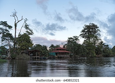 Sunset over a settlement at the Tortuguero river, Costa Rica