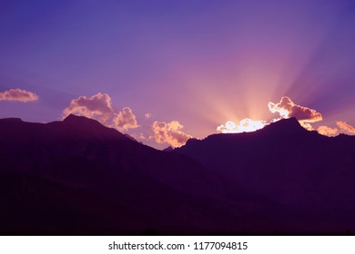 Sunset over silhouette mountains