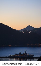 sunset over Simon's Bay, with ship moored in Simon's Town harbour, Cape Town, False Bay, South Africa, Atlantic Ocean