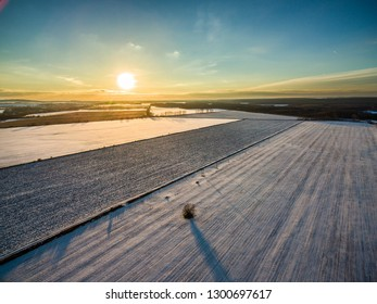 Sunset over the snowy landscape