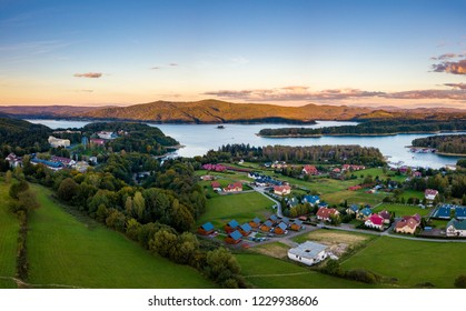 Sunset over Solina lake and Polanczyk village in Bieszczady mountains in Poland. Aerial photography.