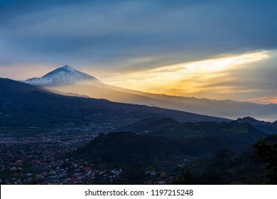 Sunset over Tenerife landscape with volcano Pico del Teide in snow. Winter in Canary Island