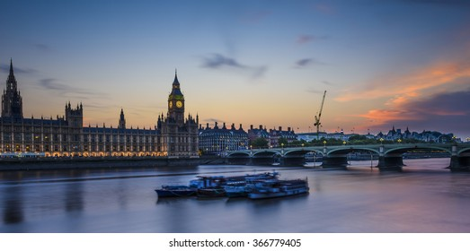 Sunset over the Thames River, House of Parliament and Westminster Bridge, view form River South Bank, London, United Kingdom.