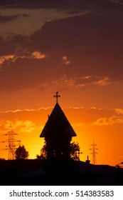 Sunset over the town with church tower, Tulcea, Romania.