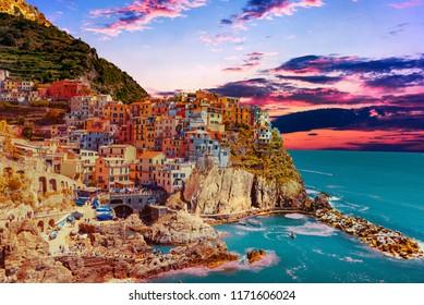 sunset over the town of Manarola delle Cinque Terre in Liguria Italy