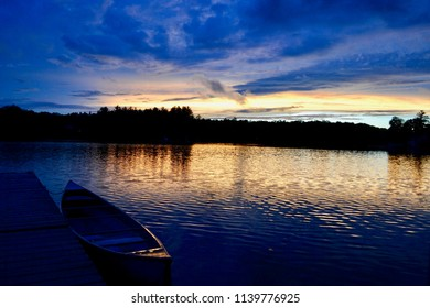 Sunset over a tranquil lake in Greenville, Michigan