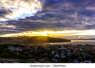 Sunset over Trondheim. Panorama of the city, top view. Norway