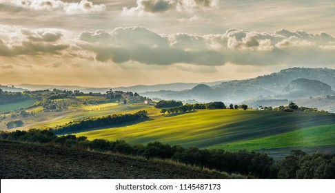 Sunset over a Tuscan valey in autumn