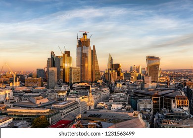 Sunset over the urban skyline of the financial district City of London, United Kingdom