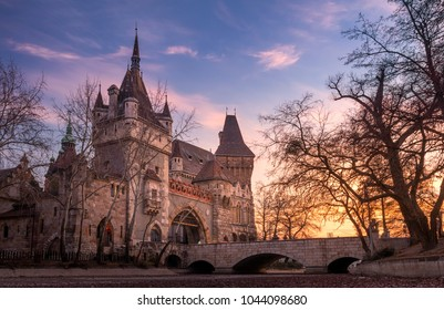 Sunset over Vajdahunyad Castle in the City Park of Budapest, Hungary.