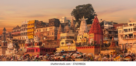 Sunset over Varanasi.  Text translation = Prayag Ghat