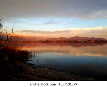 Sunset over varese lake with pink and red sky in italy