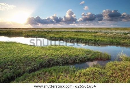 sunset over Wadde sea coast, Friesland, Netherlands