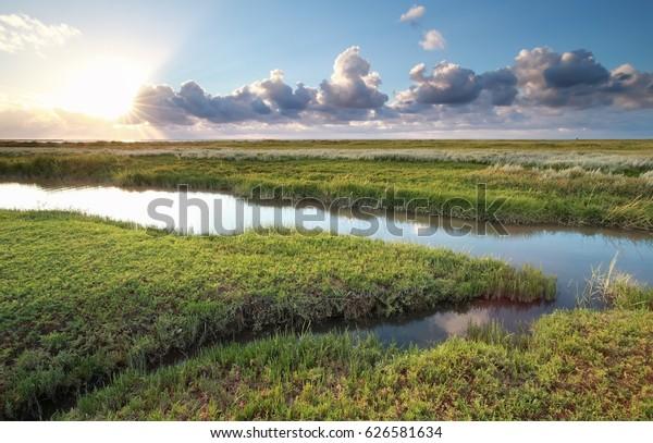 sunset over Wadde sea coast, Friesland, Netherlands