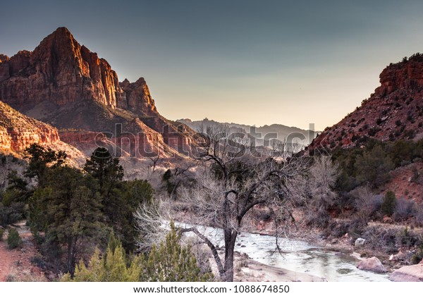 Sunset over the Watchman cliff formation and the Virgin River at Zion National Park, Utah in the Winter