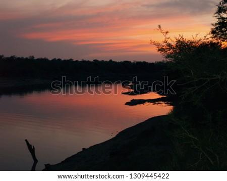sunset-over-water-timbavati-game-450w-13