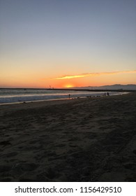 Sunset over the waves at Playa Del Rey Beach in Los Angeles, California.