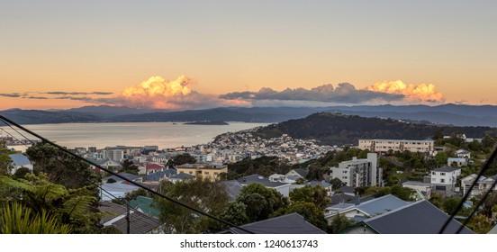 Sunset over Wellington city harbor, New Zealand