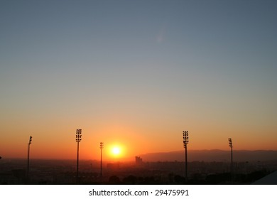 sunset over west barcelona soccer stadium