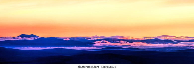 Sunset over the west coast of the Scottish Highlands from the summit of Ben Horn in Sutherland