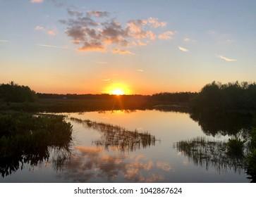 A sunset over a wildlife refuge in Florida