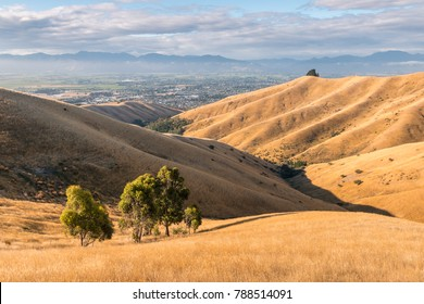 sunset over Wither Hills with Blenheim town in background, New Zealand