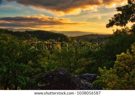 Sunset over a wooded valley