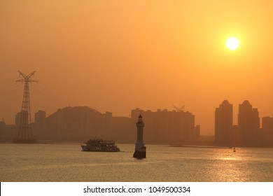 Sunset over Xiamen harbour in China.