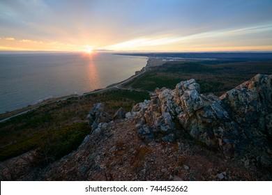 Sunset overlooking the LNG plant through evening haze, Sakhalin island, Russia