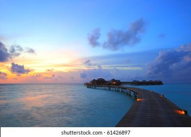 sunset and overwater villas