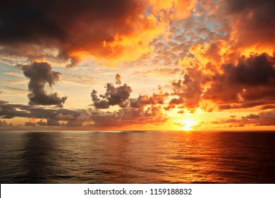 Sunset in the Pacific Ocean. Various types of sunset from the side of the ship when underway and anchored in the port. Riot of colors of the ocean, clouds and sun.