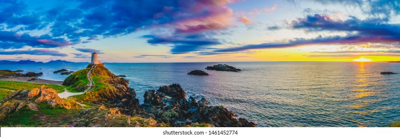 Sunset panorama of Lighthouse on Llanddwyn Island at the coast of Anglesey in North Wales,UK