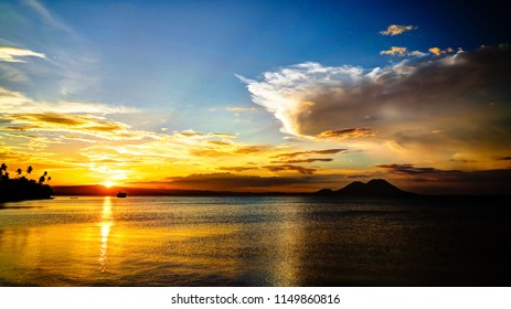 Sunset panorama with Tavurvur volcano at Rabaul, New Britain island in Papua New Guinea
