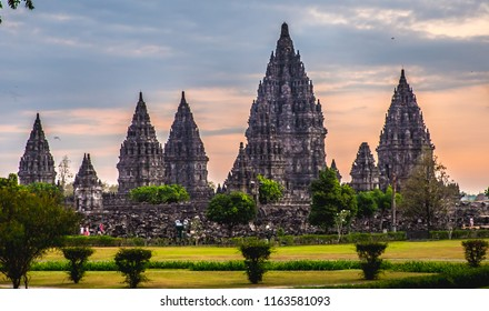Sunset  Panoramic view  at the Hindu temple Prambanan with colorful sky at UNESCO heritage site   -  Yogyakarta Java, Indonesia.