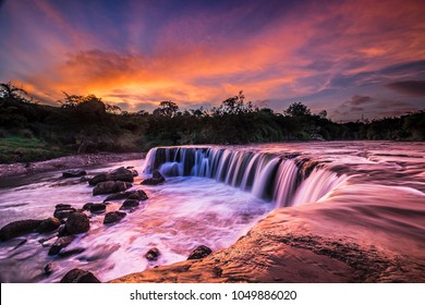Sunset Parigi Waterfall, Indonesia