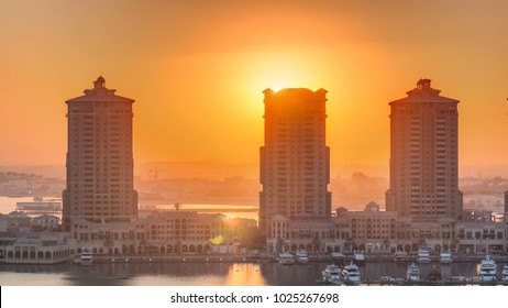 Sunset at the Pearl-Qatar timelapse from top. It is an artificial island in Qatar. View of the Marina and residential buildings in Porto Arabia in Doha, Qatar, Middle East