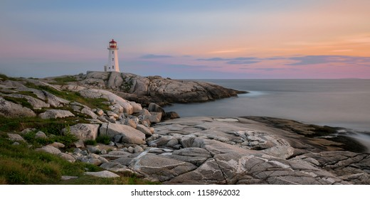 Sunset at Peggy's Point, or Peggy's Cove, Lighthouse at Peggy's Cove, Nova Scotia on July 16, 2018