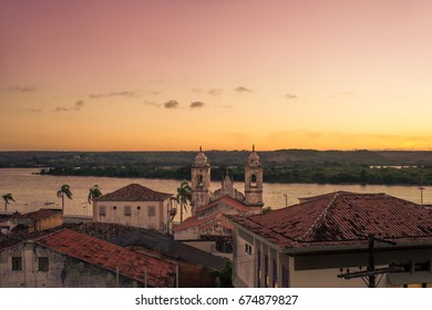 Sunset in Penedo, Alagoas, with the back of colonial houses ans São Francisco River